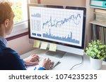 home trader analyzing forex ... | Shutterstock . vector #1074235235