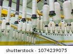 coarse cotton factory in... | Shutterstock . vector #1074239075