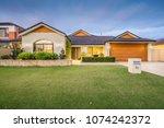 modern single storey suburban... | Shutterstock . vector #1074242372