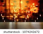 top of wood table with light of ... | Shutterstock . vector #1074242672
