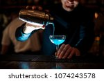 smiling barman pouring fresh... | Shutterstock . vector #1074243578