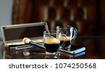 cup of coffee with the phone... | Shutterstock . vector #1074250568