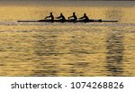 four person rowing sport | Shutterstock . vector #1074268826