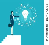 business woman on top of the...   Shutterstock .eps vector #1074272786