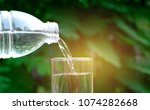 hand holding water glass and... | Shutterstock . vector #1074282668