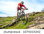 cyclist in red jacket riding... | Shutterstock . vector #1074315242
