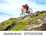 cyclist in red jacket riding... | Shutterstock . vector #1074315248