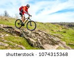 cyclist in red jacket riding... | Shutterstock . vector #1074315368