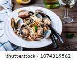traditional italian seafood... | Shutterstock . vector #1074319562
