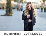 blonde woman texting with her... | Shutterstock . vector #1074320192