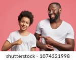 positive small kid with afro...   Shutterstock . vector #1074321998
