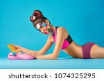 pop art model lying on blue... | Shutterstock . vector #1074325295