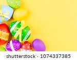 colorful easter eggs on yellow... | Shutterstock . vector #1074337385