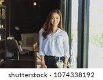 asian women standing smiling... | Shutterstock . vector #1074338192