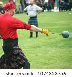 Stock photo strong man throwing weight at scottish highland games 1074353756