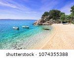 Beautiful beach near Brela town, Dalmatia, Croatia. Makarska riviera, famous landmark and travel touristic destination in Europe - stock photo