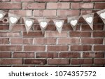 brown woven party flags with... | Shutterstock . vector #1074357572