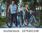 attractive family dressed in... | Shutterstock . vector #1074361148