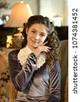 Small photo of portrait of a gentle romantic cute modest lady girl in vintage clothes