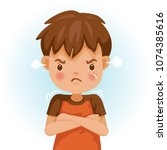 angry child. the boy in a red... | Shutterstock .eps vector #1074385616