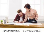 two colleagues discussing...   Shutterstock . vector #1074392468