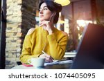 young woman working on laptop... | Shutterstock . vector #1074405095