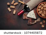 bottle of wine  blue cheese ... | Shutterstock . vector #1074405872
