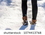 woman in snow boots and... | Shutterstock . vector #1074413768