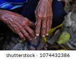 wrinkled hands of an old man. | Shutterstock . vector #1074432386