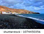 black beach of giniginamar...   Shutterstock . vector #1074450356