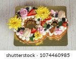 cake with natural flower | Shutterstock . vector #1074460985