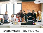 group of young multiethnic... | Shutterstock . vector #1074477752
