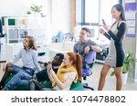multi ethnic friends are... | Shutterstock . vector #1074478802
