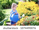 young girl is enjoying garden... | Shutterstock . vector #1074490076