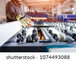 conveyor belt for production a... | Shutterstock . vector #1074493088