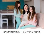 happy family  mom and daughters ... | Shutterstock . vector #1074497045