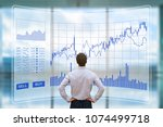 trader analyzing forex  foreign ... | Shutterstock . vector #1074499718
