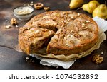pear pie with walnuts and... | Shutterstock . vector #1074532892