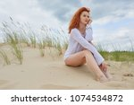 young woman on sand to...   Shutterstock . vector #1074534872