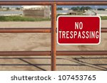 Red No Trespassing Sign On An...