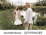 a beautiful couple in free... | Shutterstock . vector #1074546185