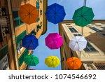 multicolored umbrellas in the...   Shutterstock . vector #1074546692