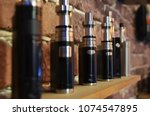 electronic cigarette on a... | Shutterstock . vector #1074547895