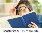 woman suffering eyestrain... | Shutterstock . vector #1074553682