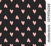repeating pink hearts on black... | Shutterstock .eps vector #1074556268