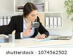 suspicious executive analyzing... | Shutterstock . vector #1074562502