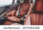 new car in showroom. luxury... | Shutterstock . vector #1074563108