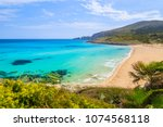 view of sandy cala mesquida bay ... | Shutterstock . vector #1074568118