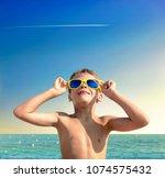 portrait of dreamy boy in... | Shutterstock . vector #1074575432