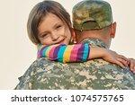 family members welcomed back.... | Shutterstock . vector #1074575765